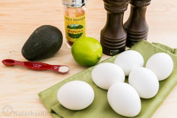 Ingredients for guacamole stuffed eggs on the table