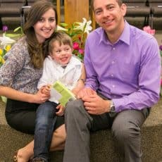 Natasha and her family smiling at the camera at church