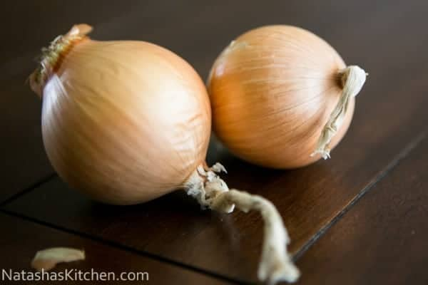 Two whole onions on the table