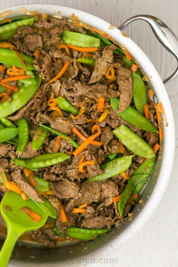 This stir fry is healthy and light with it's fresh orange sauce. The flavor is extremely satisfying and it's super quick to make with just 30 mins of prep.