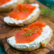 These smoked salmon tea sandwiches (crostini) show up at 90% of our parties. Everyone loves them. The cream cheese dill spread is wonderful!