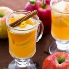 Honey apple cider served in a cup garnished with cinnamon stick