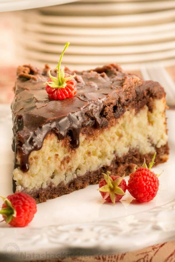This Cheese Chocolate Cake has a generous layer of farmers cheese sandwiched between two layers of chocolate crust and covered with a chocolate glaze.