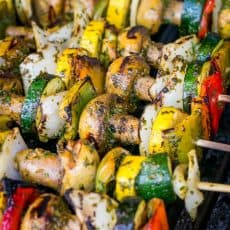 A close up of Moroccan vegetable skewers on a grill
