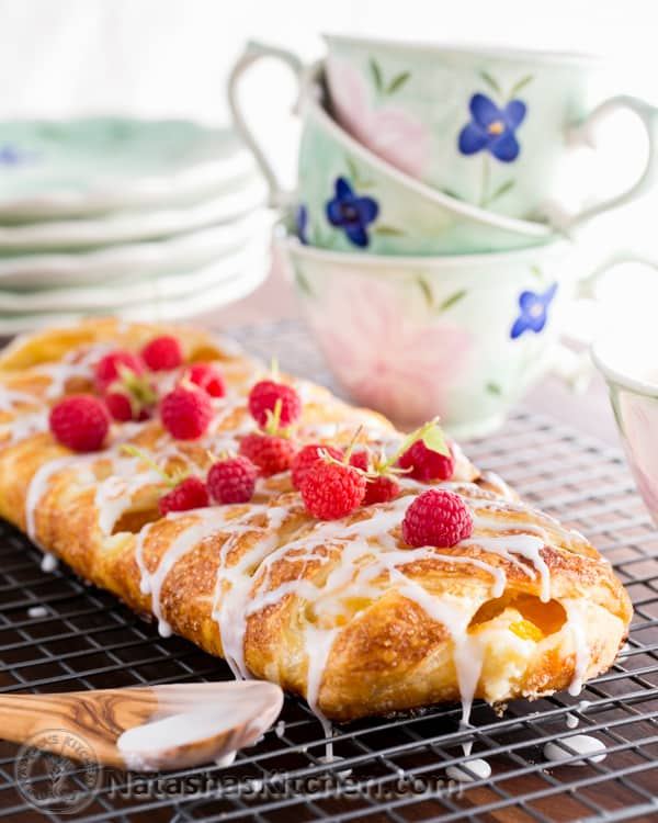 You'll make this braided danish again and again. It has a cheesecake center and is loaded with peaches. This braided danish is easier than you think! How To make braided danish | natashaskitchen.com