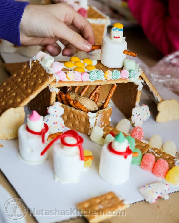 A gingerbread house being put together