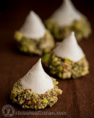 These Meringue Acorns are a real show stopper and taste heavenly. Vanilla meringue surrounded by melted chocolate truffles and covered with salty nuttiness.