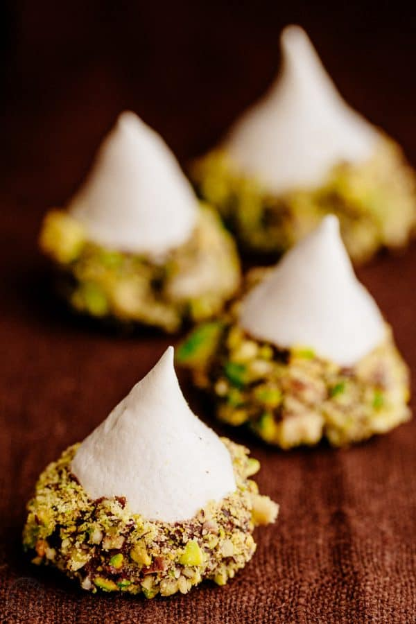 These Meringue Acorns are a real show stopper and taste heavenly. Vanilla meringue surrounded by melted chocolate truffles and covered with salty nuttiness | natashaskitchen.com