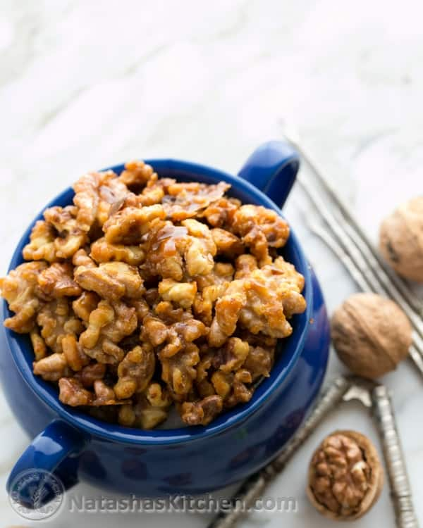 These caramelized, candied walnuts are quite a treat. Toss them into your salad, over popcorn, or straight into your mouth. Crunch. Crunch.