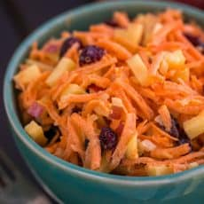 A close up of a bowl of carrot and apple salad