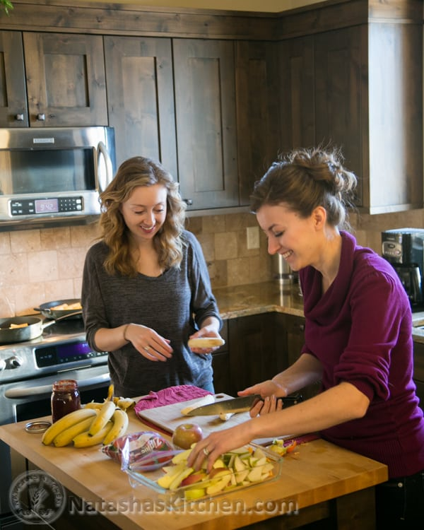 Natasha and another woman preparing food in a kitchen