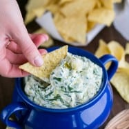 This skinny spinach and artichoke dip uses Greek yogurt. Serve it warm and cheesy. It's perfect for game day or any occasion.