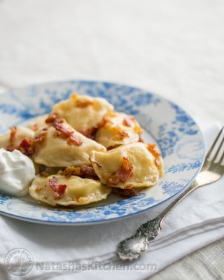 These Vareniki - Ukrainian classic pierogi, loaded with cheesy potatoes and an easy melt in your mouth homemade dough! Step by step photos.