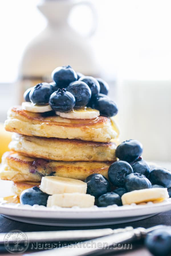 Fluffy Sour Cream Blueberry pancakes. @NatashasKitchen