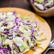 "This Creamy Coconut Coleslaw is delicious in a sandwich or over fish tacos. , a ""copycat"" of the famous ""France's Coleslaw"" we tried in Coconuts Fish Cafe."