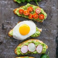 Five varieties of open-faced avocado spread sandwiches