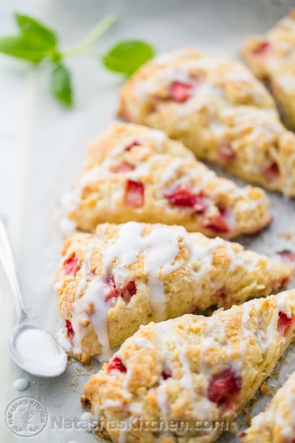 These strawberry scones are perfect! Soft, crumbly and studded with plenty of fresh strawberries. The generously amount of sweet glaze takes these over the top! @NatashasKitchen