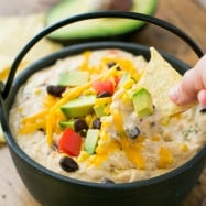 This Southwest hot chicken dip is cheesy, loaded with corn, black beans, and has just the right amount of heat from the jalapeños. Enjoy one pot recipe!