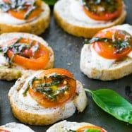 Caprese Crostini are an easy and tasty appetizer to serve at parties. They only take about 10 minutes to assemble, but they look fancy and taste great.
