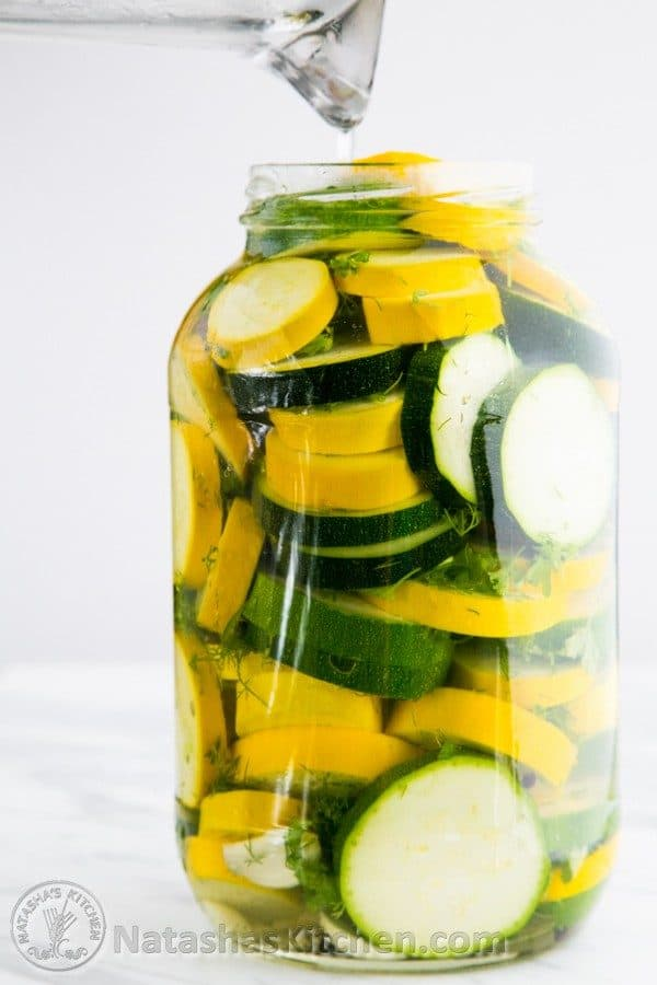 A glass jar of pickled zucchini