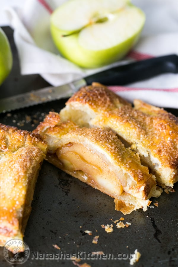 Caramelized apples wrapped in flaky puff pastry dough. So EASY and delicious! @natashaskitchen