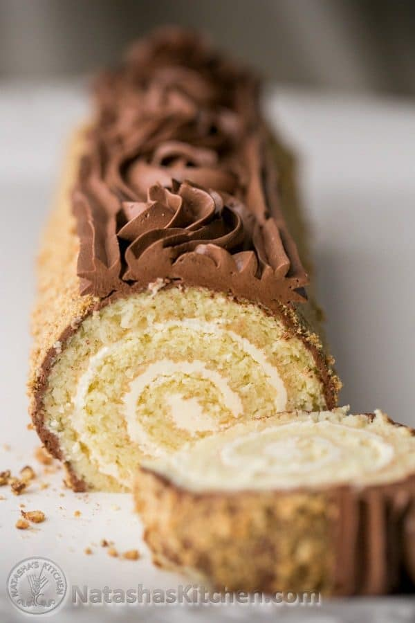You have to try this cake roll! Moist, chocolatey & stunning. Step-by-step photos! @natashaskitchen