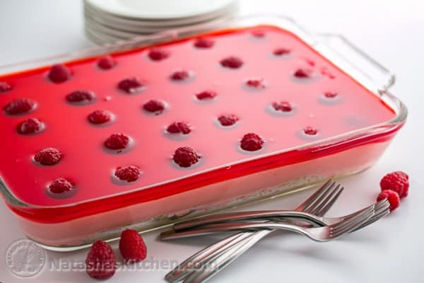 Raspberry Jello Cake Recipe - Perfect for parties and potlucks and it's kid-friendly! (Video Recipe Included) @natashaskitchen