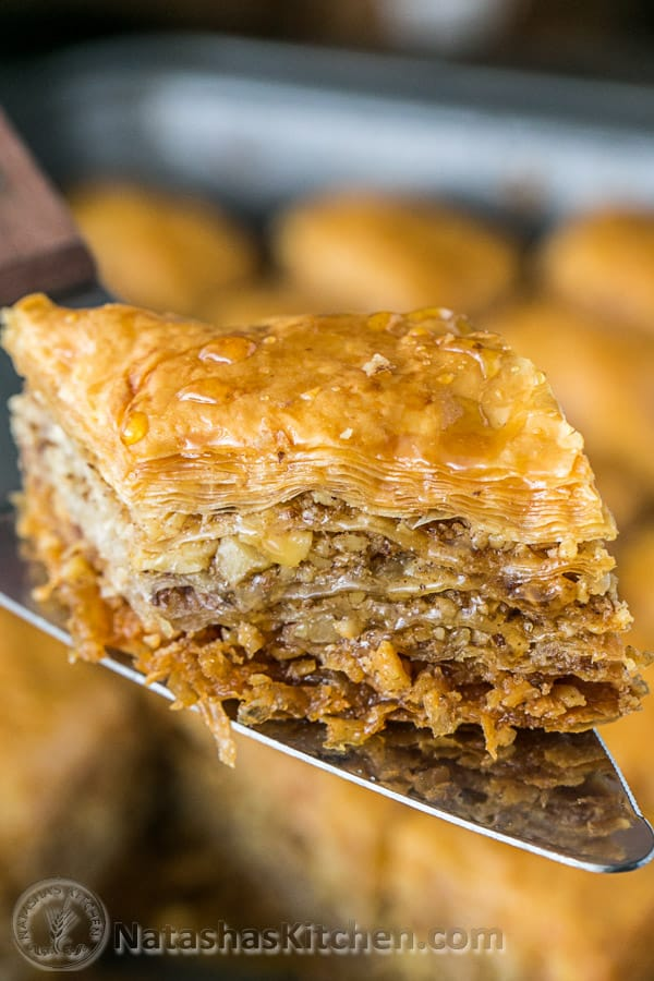 Slice of baklava coming out of serving pan for baklava and how to cut baklava