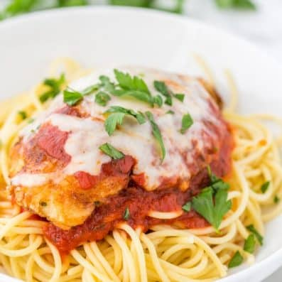 Chicken Parmesan over bed of pasta
