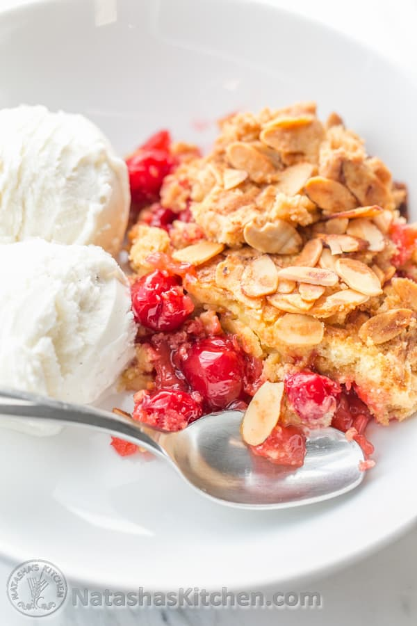 This Cherry Pineapple Dump Cake has just 5 ingredients. Ridiculously EASY! @natashaskitchen