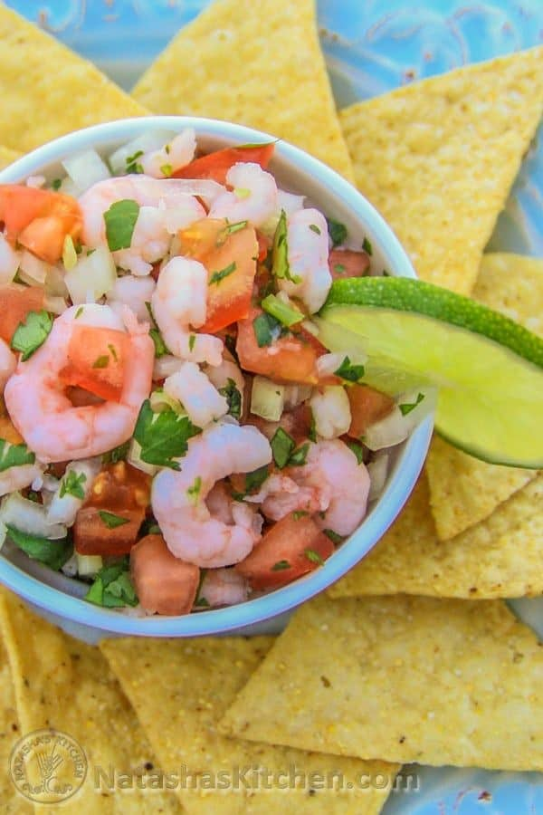 This Mexican Ceviche can be compared to a shrimp salsa. It's loaded with tomatoes, onion and cilantro. Sprinkle it with hot sauce and serve!