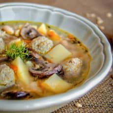 A white bowl of turkey meatball soup