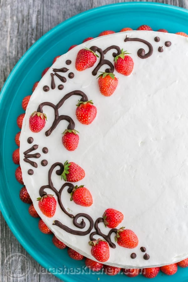 Cake decorated with fresh strawberries and chocolate designs for how to decorate a cake with chocolate and fruit