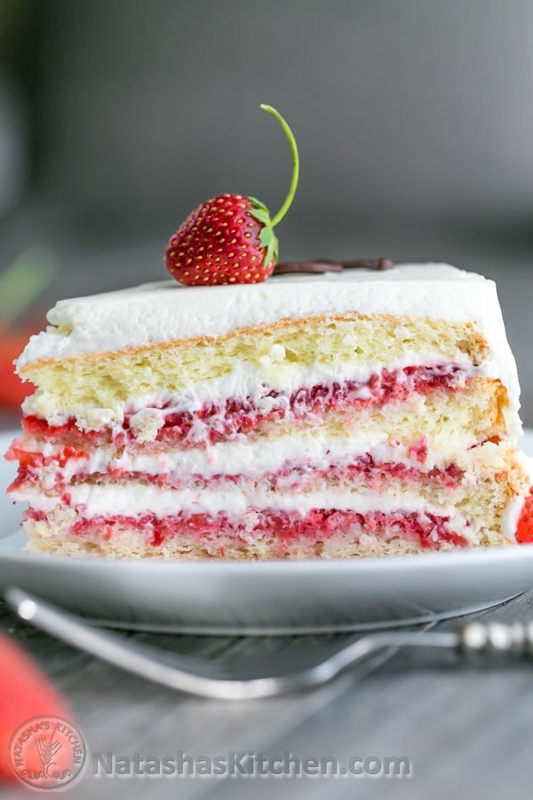 This is THE Strawberry Cake!! It calls for 1 1/2 lbs of fresh strawberries & the whipped cream cheese frosting is simple & delicious. | natashaskitchen.com