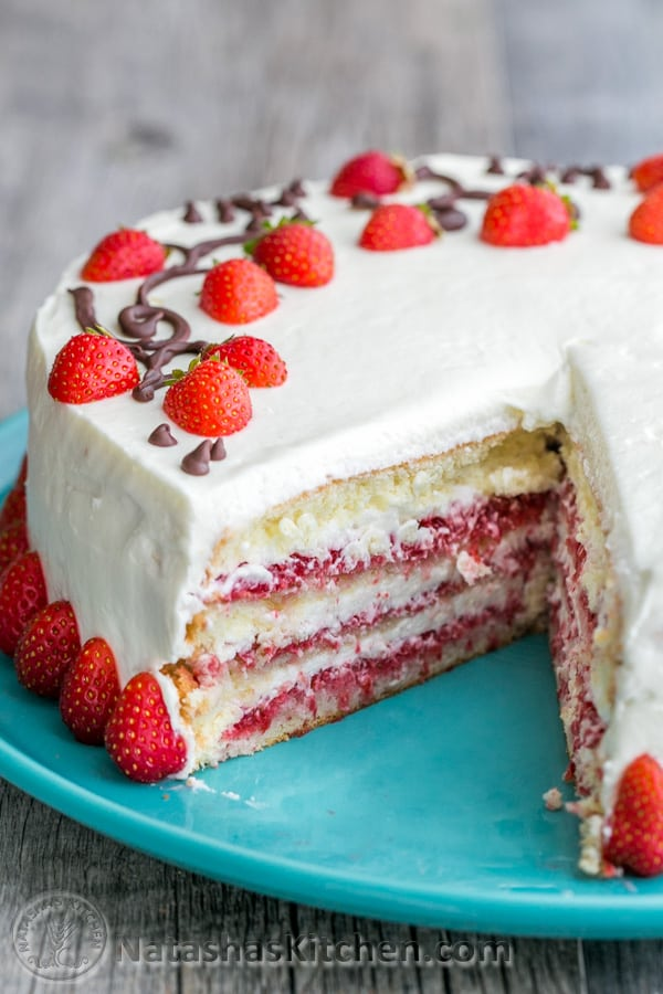 Loaded strawberry cake recipe with layers of fresh strawberries and whipped cream cheese frosting