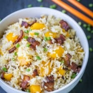 We love this bacon mango fried rice! The mango caramelizes with the crisp bacon - so good! 3 ingredients, 1 pan, 15 min | natashaskitchen.com