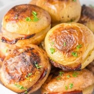 These baked potatoes have a crisp salty skin, creamy center are infused with bacon and buttery goodness... | natashaskitchen.com