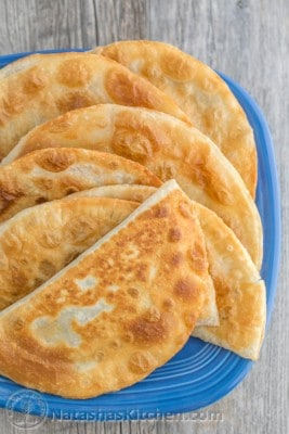 A close-up plate of cabbage and mushroom chebureki