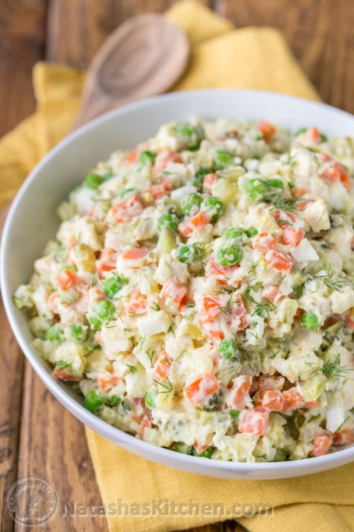 The most exciting potato salad you'll try! This chicken olivye is a favorite at church potlucks. | natashaskitchen.com