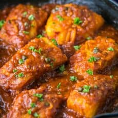Cod fish in Tomato Sauce. The fish is flaky and juicy and the sauce is legit! | natashaskitchen.com