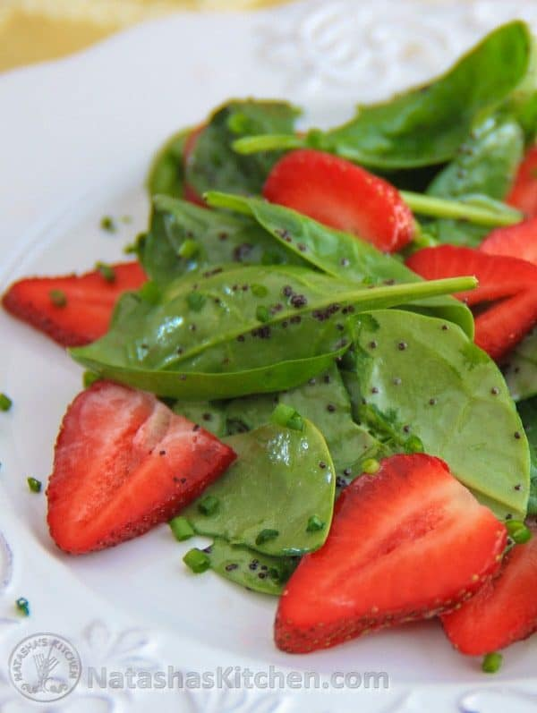 Spinach strawberry salad on a white plate