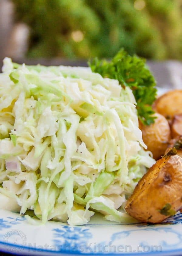 A plate with creamy apple coleslaw