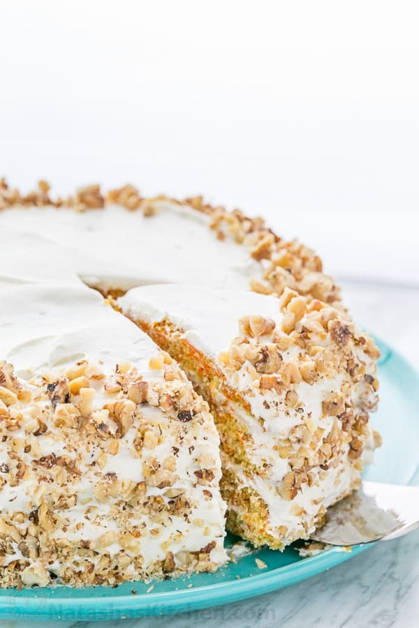 This Classic Carrot Cake has been handed down through generations. Soft, moist, marshmallow-like frosting and not overly sweet. YUM! | natashaskitchen.com