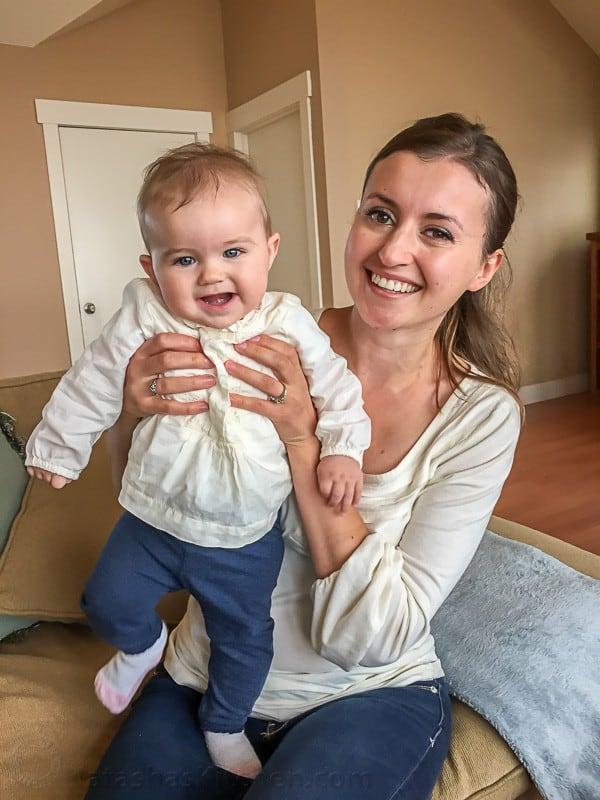 Natasha holding up her baby daughter