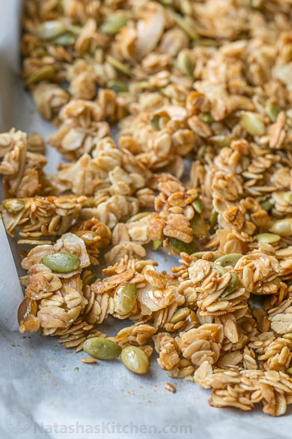 baked homemade granola on a baking sheet to show crunchy cluster texture