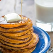 These pumpkin pancakes taste like pumpkin pie in pancake form. They're wonderfully smooth in the center. Creamy, dreamy, delicious! | natashaskitchen.com