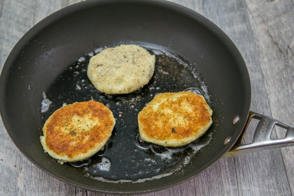 Mashed potato pancakes are a creative way to use leftover mashed potatoes! These are stuffed with a juicy meat filling - delicious! | natashaskitchen.com