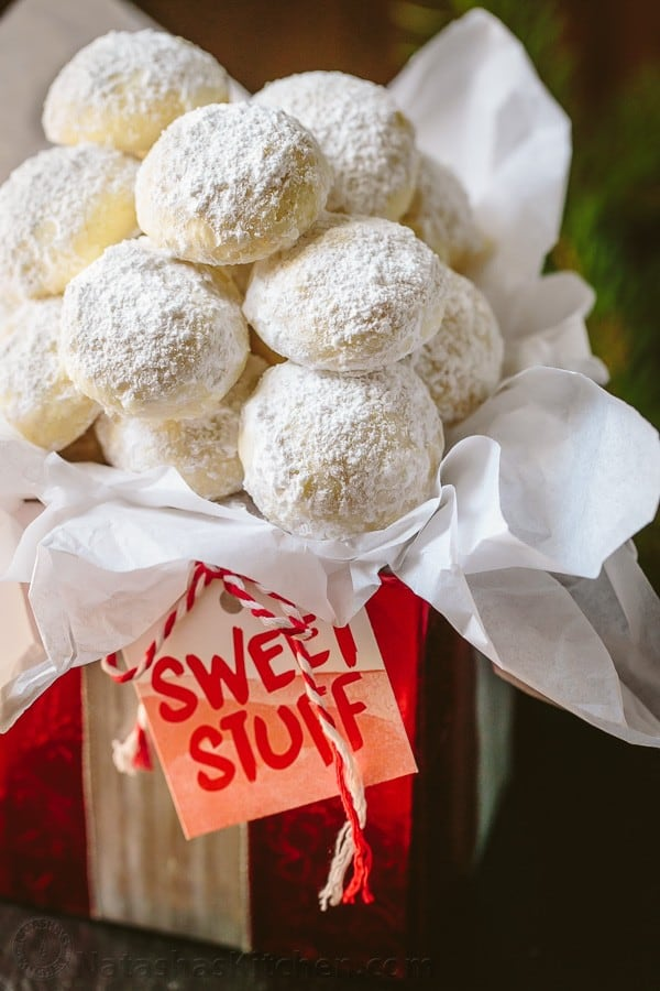 Snowball cookies wrapped in a box for Christmas cookies gift