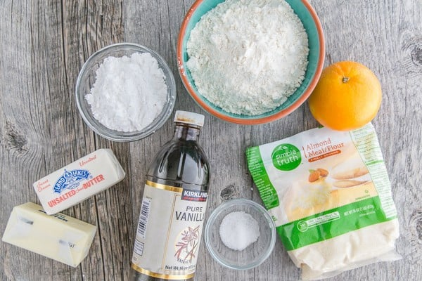 Ingredients for snowball cookies with almond flour, butter and orange zest