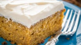 This Easy Pumpkin Cake is done in 4 steps (with frosting)! The moist, delicate crumb and marshmallow-like whipped cream cheese frosting is irresistible!